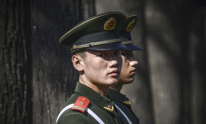 Paramilitary police officers stand guard outside the Great Hall of the People in Beijing on March 2, 2017. (Wang Zhao/AFP/Getty Images)