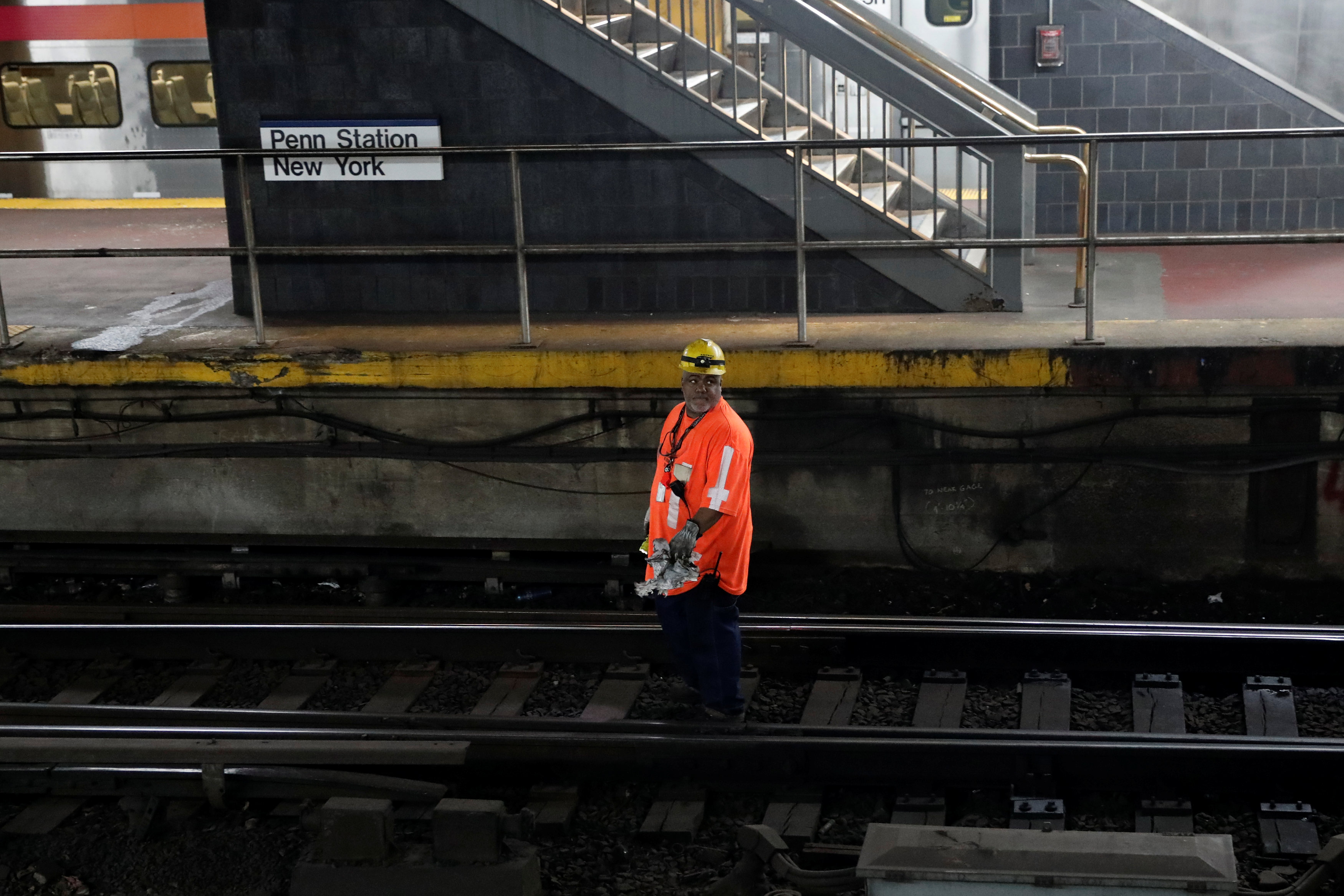 A worker walks on tracks inside New York City's Pennsylvania Station on April 27, 2017. (REUTERS/Mike Segar)