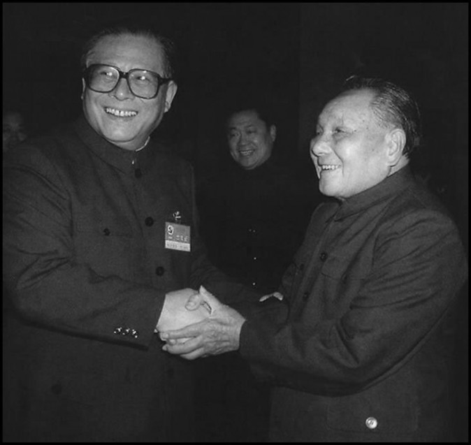 Former Chinese Communist Party leader Deng Xiaoping (R) and his successor Jiang Zemin shake hands in October 1992. Deng launched Chinese capitalist transformation and Jiang built a sprawling factional network supported by the corruption endemic to the one-party state. (AFP/Getty Images)