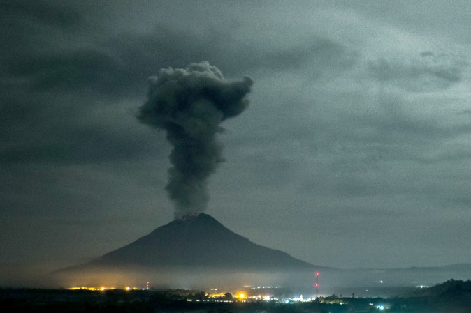 Mount Sinabung volcano spews thick volcanic ash as seen from Beganding village in Karo, Indonesia, on May 2, 2017. Sinabung roared back to life in 2010 for the first time in 400 years. (TIBTA PANGIN/AFP/Getty Images)