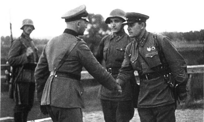 A German and a Soviet officer shaking hands at the end of the Invasion of Poland. The Nazi and communist regimes divided the country in two and visited great suffering upon the inhabitants. (	Unknown war correspondent/TASS/Public Domain)