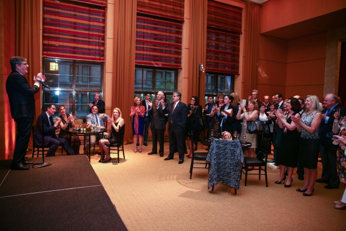 Guests and real estate agents celebrate the opening of Berkshire Hathaway HomeServices New York Properties hosted at the Four Seasons hotel in Manhattan on April 26, 2017. (Benjamin Chasteen/The Epoch Times)
