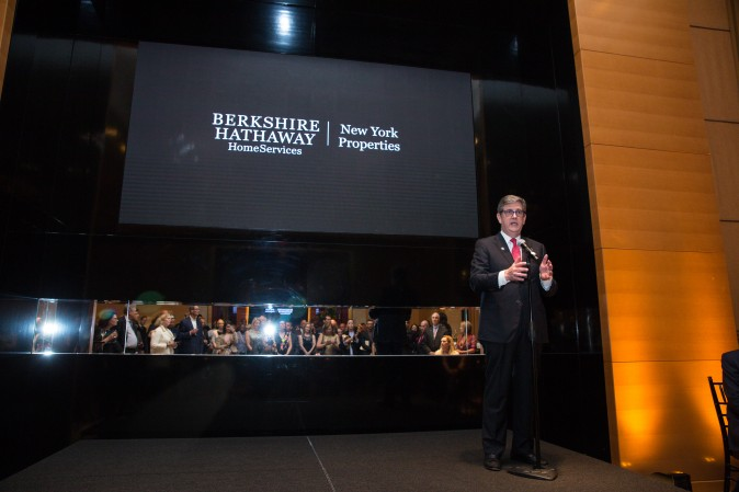Peter Turtzo, Senior Vice President at Berkshire Hathaway HomeServices speaks to guests during the celebration of their grand opening location in New York. (Benjamin Chasteen/The Epoch Times)
