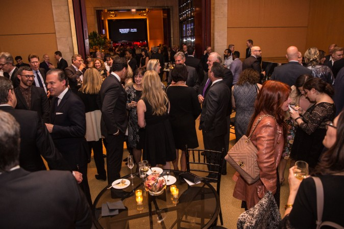 Guests and real estate agents celebrate the opening of Berkshire Hathaway HomeServices New York Properties hosted at the Four Seasons Hotel New York on April 26, 2017. (Benjamin Chasteen/The Epoch Times)