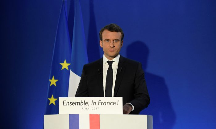 French President-elect Emmanuel Macron delivers a speech at his campaign headquarters after early results in the second round in the 2017 French presidential election in Paris, France on May 7, 2017.  (REUTERS/Lionel Bonaventure/Pool)