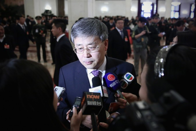 Guo Shuqing, Chairman of the China Banking Regulatory Commission, answers media questions in Beijing on March 8, 2015. (Feng Li/Getty Images)