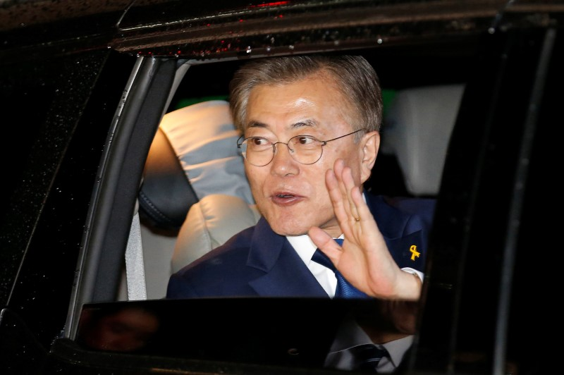 Moon Jae-in, the presidential candidate of the Democratic Party of Korea, leaves his house for his party situation room to watch live television coverage of vote count in Seoul, South Korea on May 9, 2017. (REUTERS/Kim Kyung-Hoon)