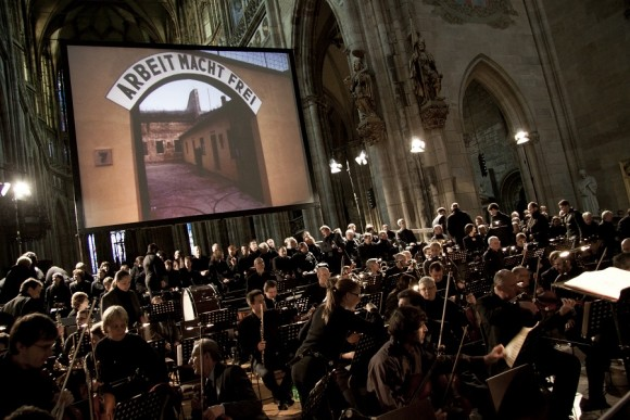 Members of the Prague Symphony Orchestra, Prague Philharmonic Choir, and the Kühn Choir of Prague take the stage before the June 6, 2013 screening of