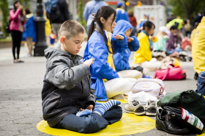 Falun Dafa practitioners participate at the World Falun Dafa Day event at Union Square, New York City, on May 11, 2017. (Samira Bouaou/The Epoch Times)