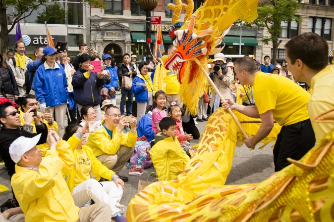 A Falun Gong dragon dance team performs at the World Falun Dafa Day event at Union Square, New York City, on May 11, 2017. (Samira Bouaou/The Epoch Times)