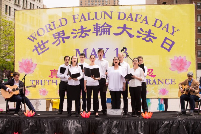 A choir of Falun Dafa practitioners sing at the World Falun Dafa Day event at Union Square, New York City, on May 11, 2017. (Larry Dye/The Epoch Times)