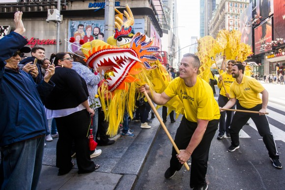 A Falun Gong dragon dance team performs in the World Falun Dafa Day parade in New York on May 12, 2017. (Samira Bouaou/The Epoch Times)