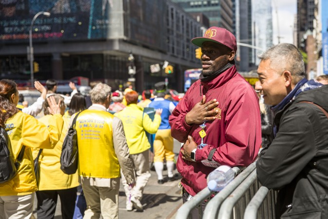 A man watches the World Falun Dafa Day parade in New York on May 12, 2017. (Samira Bouaou/The Epoch Times)