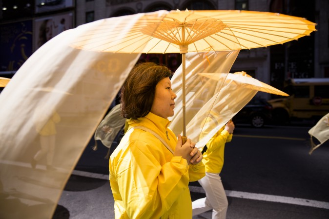 Thousands of Falun Gong practitioners march in a parade along 42nd Street in New York for World Falun Dafa Day on May 12, 2017. (Samira Bouaou/The Epoch Times)