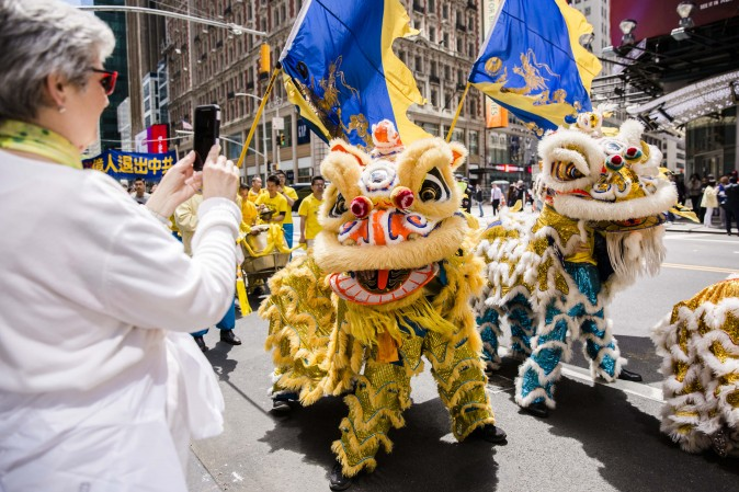 A Falun Gong lion dance team performs in the World Falun Dafa Day parade in New York on May 12, 2017. (Samira Bouaou/The Epoch Times)