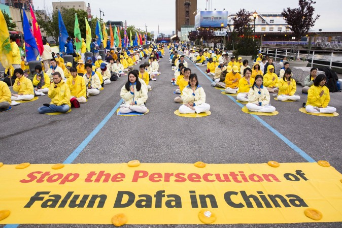 Hundreds of Falun Gong practitioners hold a vigil near the Chinese Consulate in New York on May 12, 2017. (Samira Bouaou/The Epoch Times)