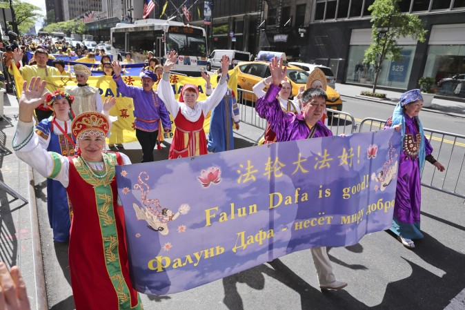Falun Gong Practitioners from Russia march in the World Falun Dafa Day parade in New York on May 12, 2017. (Edward Dye/The Epoch Times)