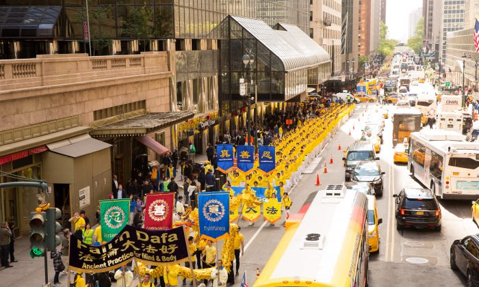 Thousands of Falun Gong practitioners march in a parade along 42nd Street in New York for World Falun Dafa Day on May 12, 2017. (Evan Ningn/The Epoch Times)