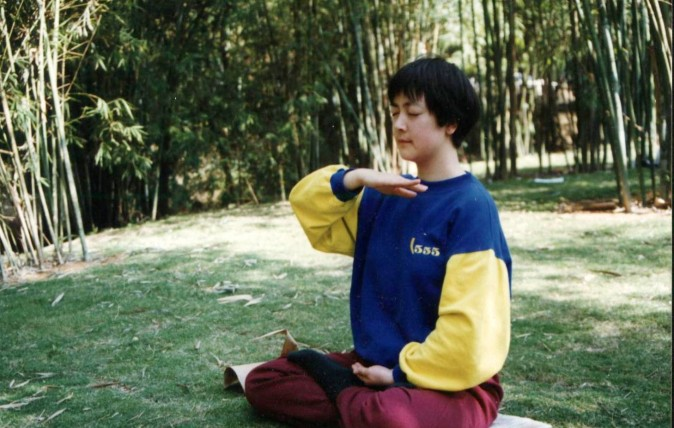 Jennifer meditating in 1998 in a park in Shenzhen City, China. (courtesy Jennifer Zeng)