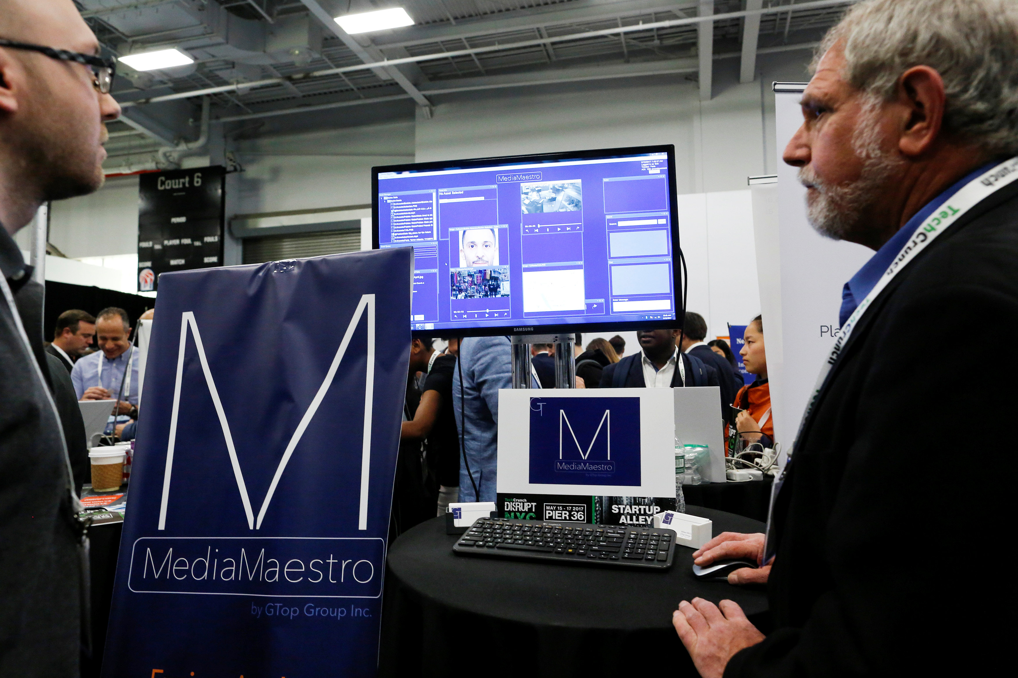 Gary Olson (R) of GTop Group gives a demonstration of their Anti-Terrorism and Situational Awareness technology platform to attendees during the TechCrunch Disrupt event in Manhattan, in New York City, NY on May 15, 2017. (REUTERS/Eduardo Munoz)