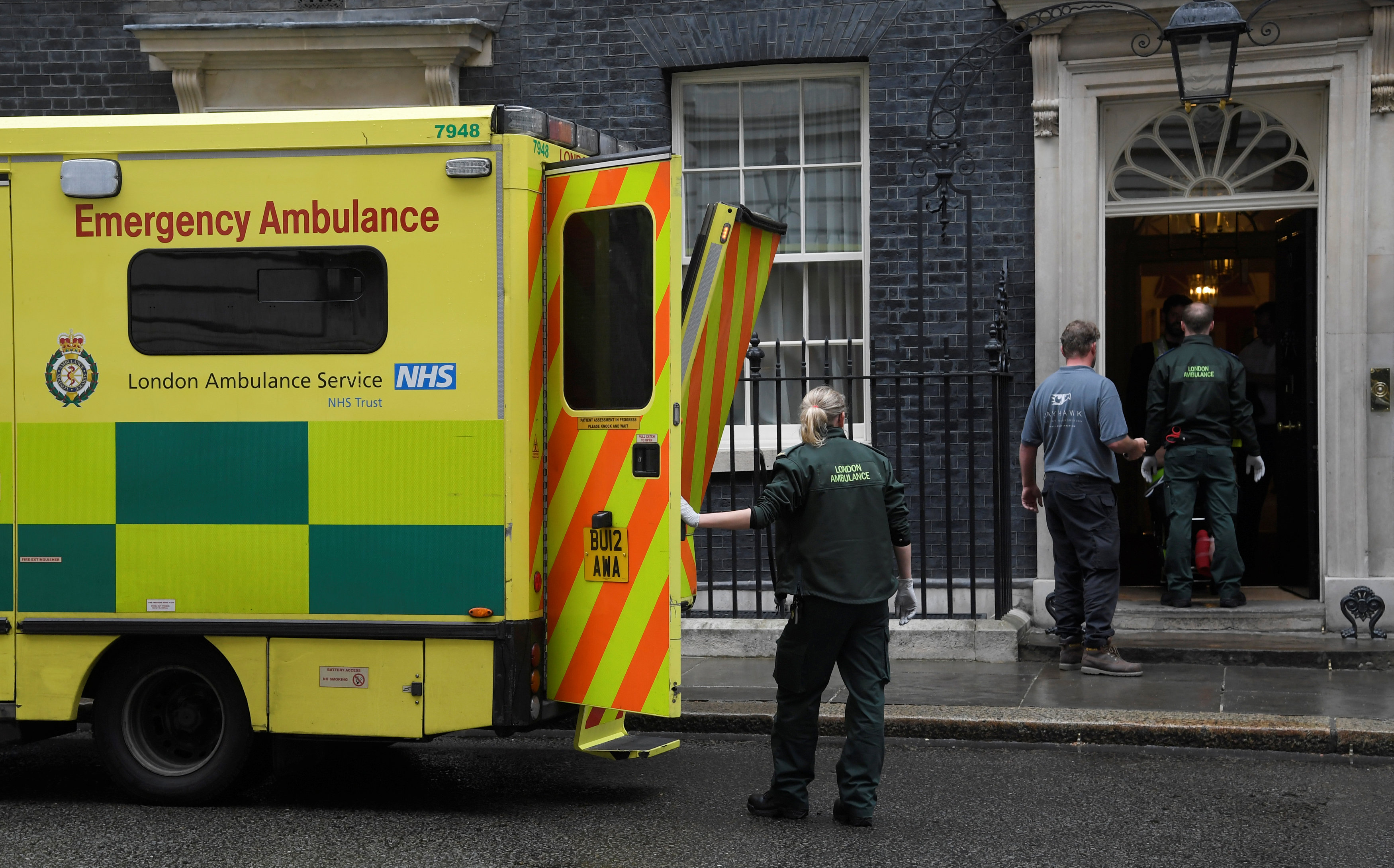 Paramedics carry a patient to an ambulance parked outside 10 Downing Street in London, Britain on May 15, 2017. (REUTERS/Toby Melville)