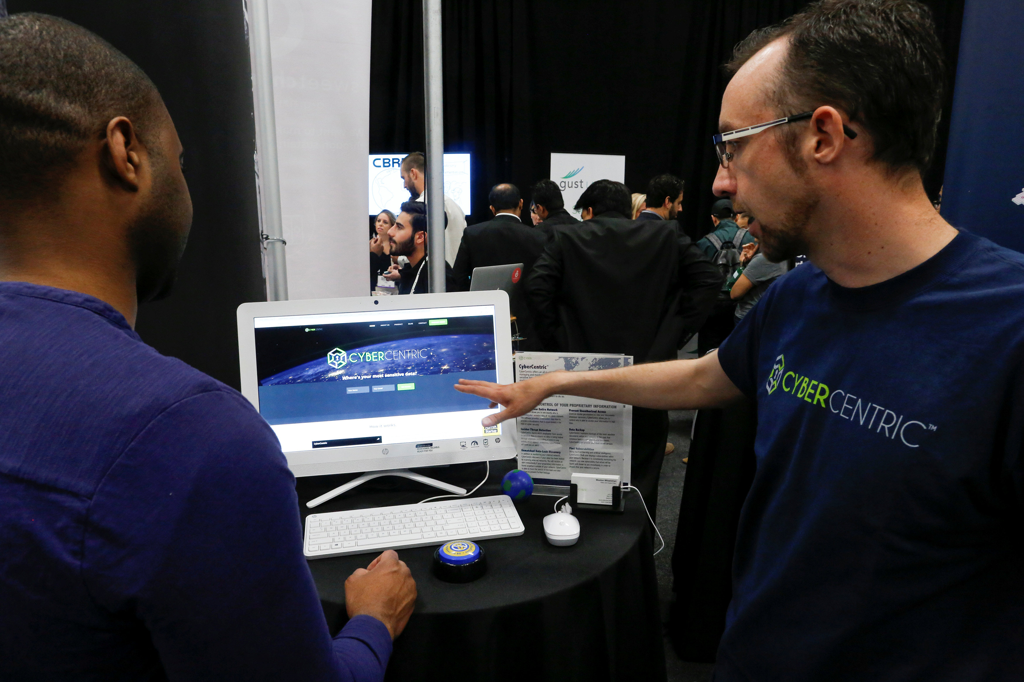 Weston Wheelehan (R) and Jeremiah Steptoe, CEO of  CyberCentric, give a demonstration of their Cybersecurity platform to attendees during the TechCrunch Disrupt event in Manhattan on May 15, 2017. (REUTERS/Eduardo Munoz)