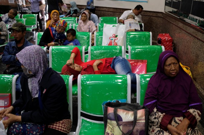 Patients and family wait for their turn to register at Dharmais Hospital, Indonesia's biggest cancer hospital, after the institution suffered the Ransomware cyber attack affecting scores of computers in Jakarta, Indonesia, on May 15, 2017. (REUTERS/Darren Whiteside)