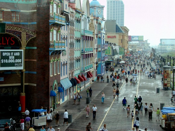 People stroll along Atlantic City's famous boardwalk. The wood is laid in a herringbone pattern. (Italo2712/English Wikipedia)
