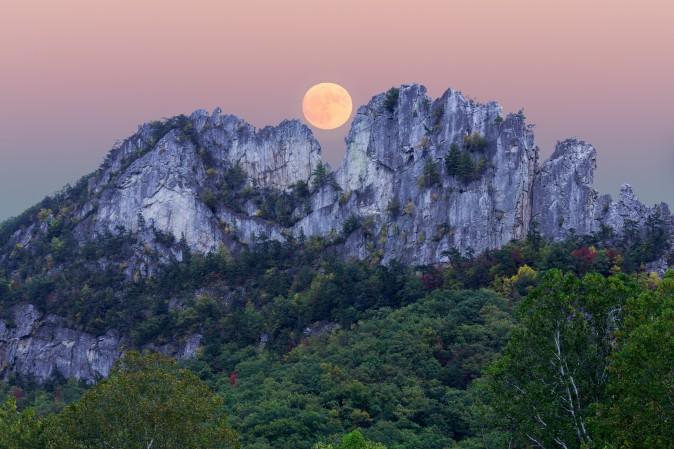 A supermoon rises over Seneca Rocks in Pendleton County, W. Va. (Steve Heap/Shutterstock)