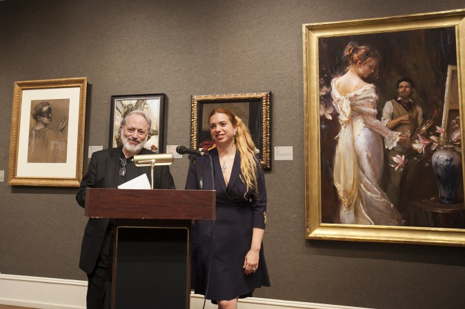 Frederick Ross, founder and chairman of Art Renewal Center (ARC), and his daughter, Kara Lusandra Ross, Director of Operations of ARC, give speeches at the press preview of the 12th International ARC Salon Exhibition at the Salmagundi Club in Manhatan, New York, on May 12, 2017. (Milene Fernandez/The Epoch Times)