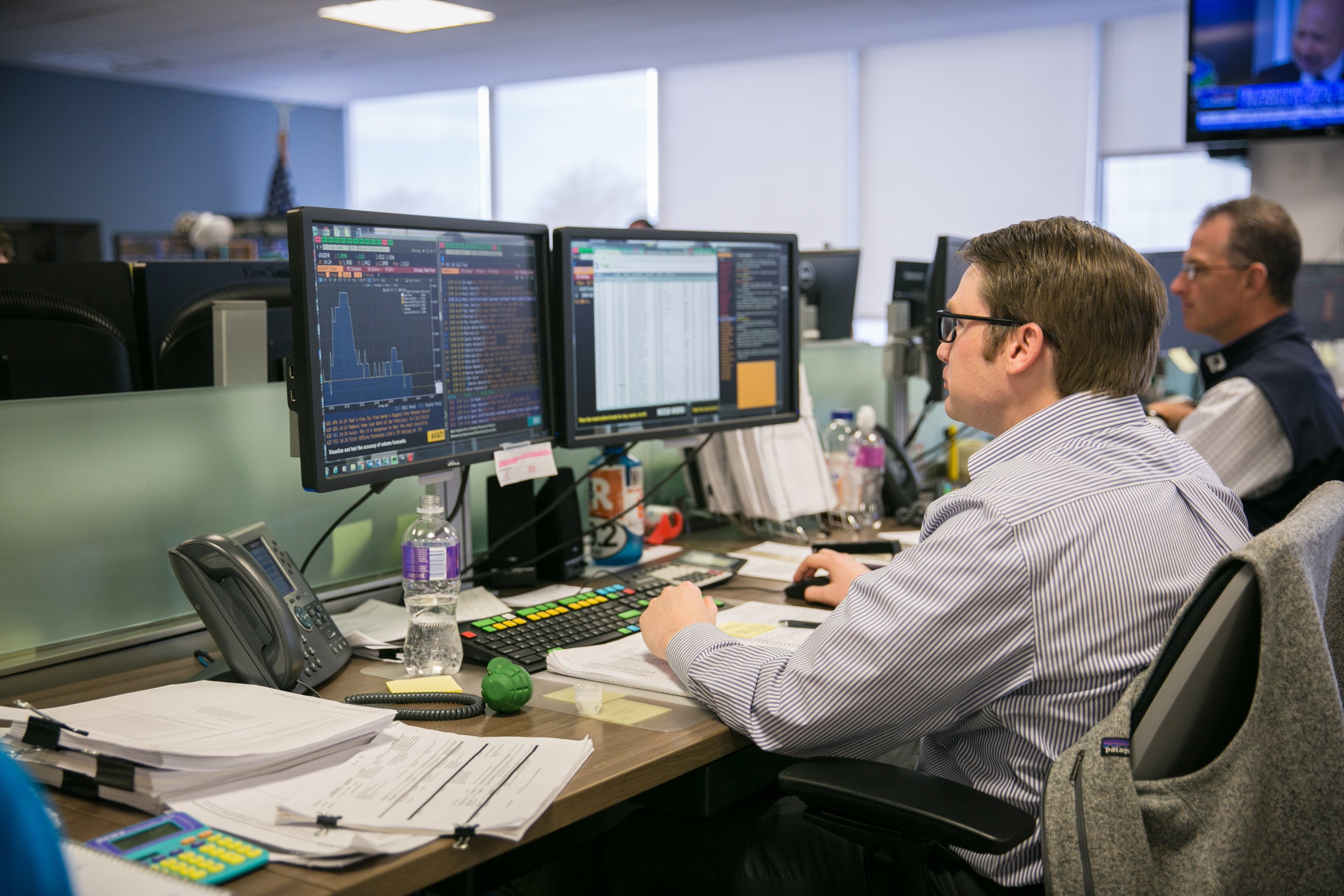 Matthew Murawski working at Drexel Hamilton office in the Financial District of Manhattan on May 9, 2017. (Benjamin Chasteen/Epoch Times)