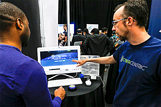 Weston Wheelehan (R) and Jeremiah Steptoe, CEO of CyberCentric, give a demonstration of their cybersecurity platform during the TechCrunch Disrupt event in New York on May 15. (REUTERS/EDUARDO MUNOZ)