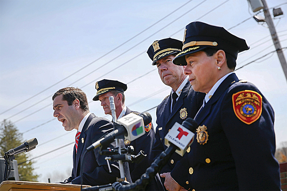 Suffolk County Police Commissioner Timothy Sini (L) at a news conference, where he offered a $25,000 reward for information leading to an arrest in the killings of four young men, in Central Islip, N.Y., on April 13. (SPENCER PLATT/GETTY IMAGES)