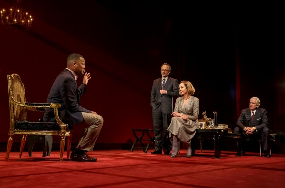 """(L–R) Paul (Corey Hawkins) cons his way into the lives of the affluent couple Ouisa (Allison Janney) and Flan (John Benjamin Hickey) while their friend Geoffrey (Michael Siberry) looks on, from """"Six Degrees of Separation."""" (Joan Marcus)"""