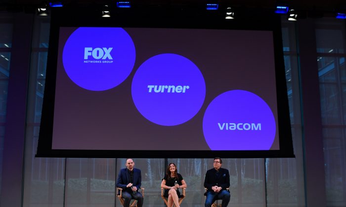 ( L-R) Joe Marchese, President of Fox Networks Group; Donna Speciale, President of Ad Sales & Marketing, Turner; and Sean Moran, Head of Marketing & Partner Solutions, Viacom speak at the OpenAP launch event April 7 in New York City.  (Dave Kotinsky/Getty Images for New Creative Mix Inc.)