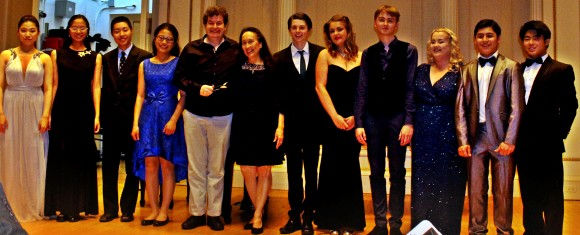 The New York Concerti Sinfonietta's 2017 International Shining Stars celebrate on stage at Carnegie Hall after Friday evening's performance :  (L–R) Yein Choi, MSM pianist; Lily Zhou, Dallas pianist; Jeremy Zhang, Dallas pianist; Sidi Bao, DIT Conservatory of Music and Drama violinist; Niall O'Leary, Irish dancer/spoons;  Julie Jordan, artistic director/founder of NY Concerti Sinfonietta; Keith Stears and Robyn Richardson, Royal Irish Academy of Music duo; Ben Gannon, Royal Irish Academy of Music oboist; Rebecca Rodgers, Royal Irish Academy of Music soprano;  Rowel Friers, Royal Irish Academy of Music pianist; Aidan Chan, DIT Conservatory of Music and Drama pianist.  (Jeremy Friers)