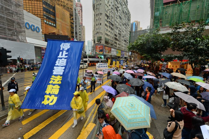 About 1,200 Falun Dafa practitioners from Hong Kong and neighboring countries  hold a parade in Hong Kong's central business district on April 23, 2017. (Song Bilong/The Epoch Times)