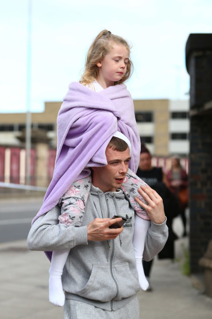 A man carries a young girl on his shoulders in Manchester, England on May 23, 2017. (Dave Thompson/Getty Images)