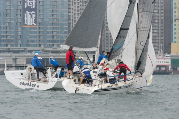 'Rampage II' just gets the inside line to the bottom mark ahead of 'Gambit' in Race 1 of the RHKYC Spring Regatta on Saturday May 20. 2017. (Bill Cox/Epoch Times)
