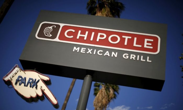 Ohio health officials say they've received 368 reports of people getting sick stemming from a Chipotle restaurant in Sawmill Parkway in Powell. Signage for a Chipotle Mexican Grill is seen in Los Angeles on April 25, 2016. (Reuters/Lucy Nicholson)
