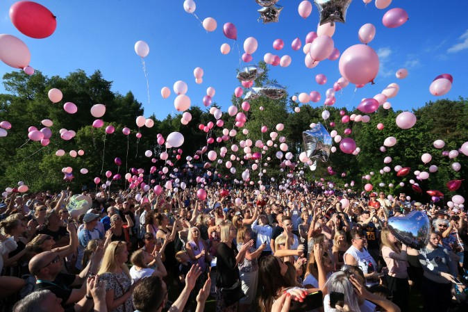 People release thousands of balloons into the sky during a vigil to commemorate the victims of the May 22 terror attack at Tandle Hill Country Park in Royton, England, on May 26, 2017. (LINDSEY PARNABY/AFP/Getty Images)
