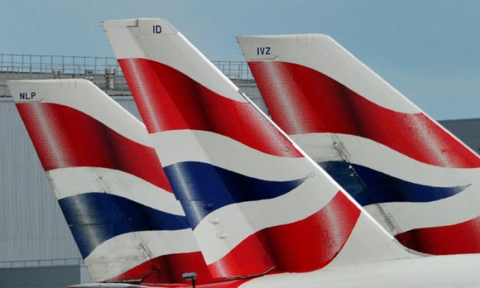 British Airways logos are seen on tailfins at Heathrow Airport in west London, Britain. (file, REUTERS/Toby Melville/Files)