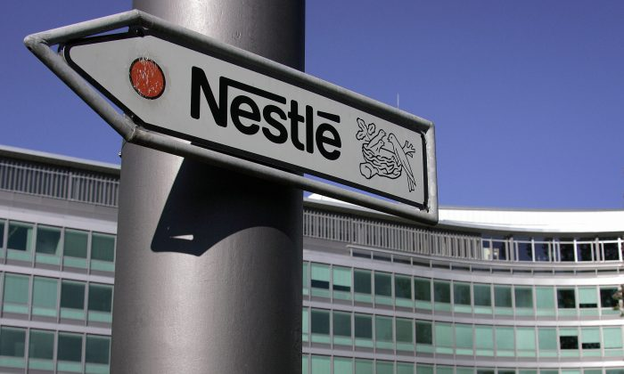 Vevey, SWITZERLAND:  (FILES) Picture taken 23 August 2006 shows a sign of Nestle, the Swiss food giant, at the company's Headquarters in Vevey, Switzerland.  Swiss food group Nestle said Wednesday 20 September 2006 that it would slash 645 jobs at a chocolate factory in the northern English city of York. The cuts, which amount to 26 percent of the workforce at the site, will start next year and continue until 2008, Nestle said in a company statement. The facility will continue to employ 1,800 staff. AFP PHOTO /FILES/ FABRICE COFFRINI  (Photo credit should read FABRICE COFFRINI/AFP/Getty Images)