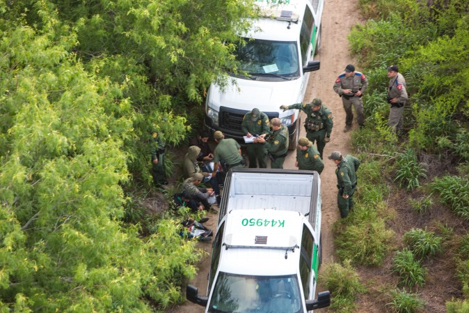 A view from a Border Patrol helicopter, shows the Texas Border Patrol and Texas State Troopers detaining aliens who were trying to remain hidden after they came over to the United States from Mexico in the Texas area of near McAllen, Texas, on May 30, 2017. (Benjamin Chasteen/The Epoch Times)