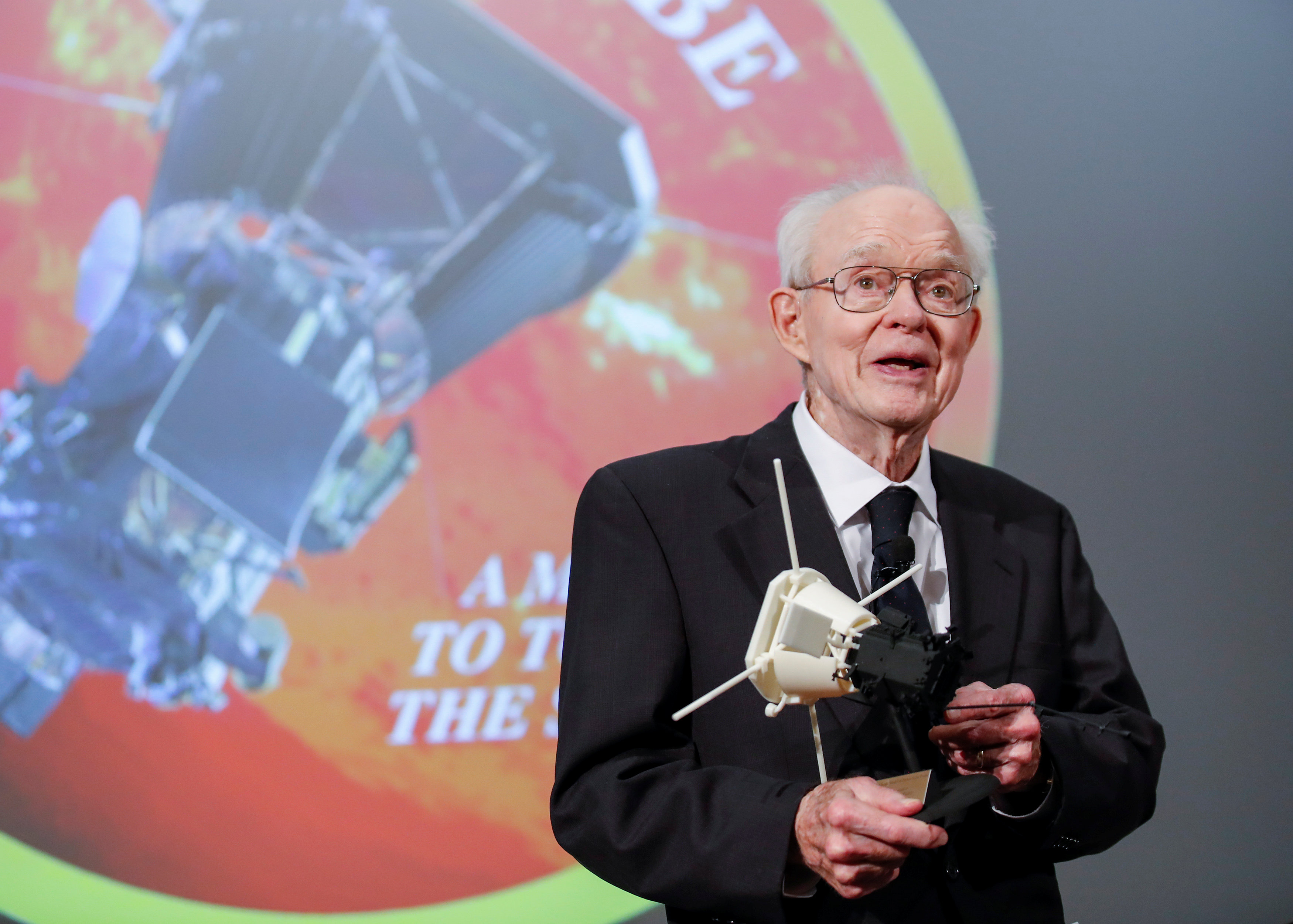 Dr. Eugene Parker, University of Chicago astrophysicist, smiles after receiving a first scale model of Parker Solar Probe during the NASA announcement on its first mission to fly directly into the sun's atmosphere at the University of Chicago in Chicago, Illinois, U.S. May 31, 2017. REUTERS/Kamil Krzaczynski