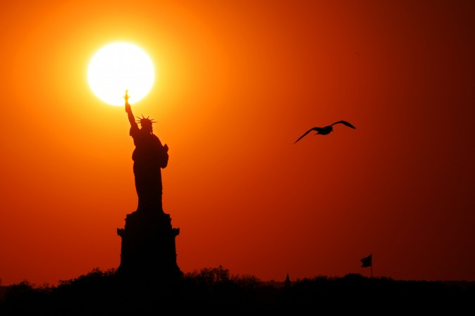 The sun sets behind the Statue of Liberty in New York City on June 02, 2017. (Michael Heiman/Getty Images)