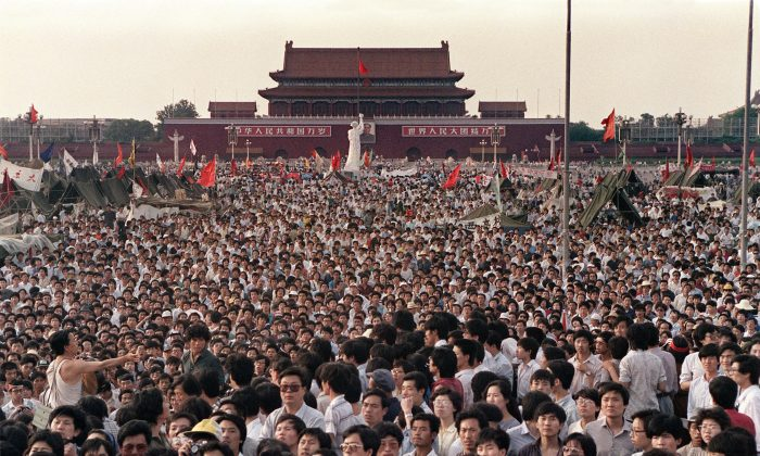 Hundreds of thousands of Chinese gathered around a replica of the Statue of Liberty, called the Goddess of Democracy, in Tiananmen Square demanding democracy despite martial law in Beijing on June 2, 1989. (Catherine Henriette/AFP/Getty Images)