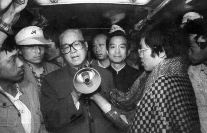 Chinese Communist Party Secretary General Zhao Ziyang (C) addresses the student hunger strikers through a megaphone at dawn 19 May 1989. (AFP/Getty Images)