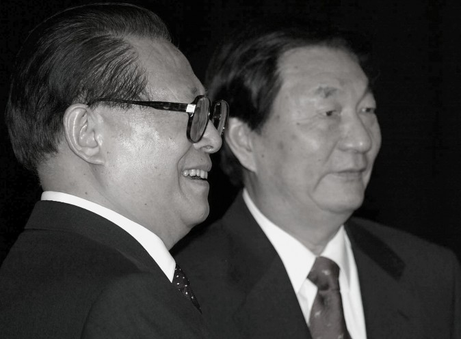 Chinese President Jiang Zemin (L) together with Premier Zhu Rongji during a departure ceremony at the Great Hall of the People in Beijing 03 June 2002. (Goh Chai Hin/AFP/Getty Images)