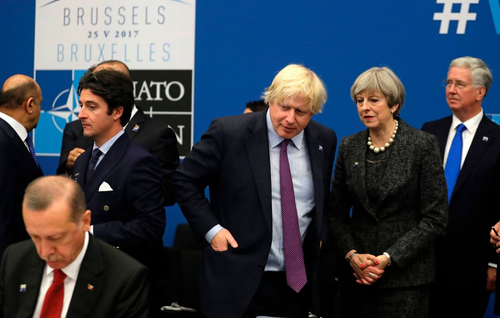 Britain's Prime Minister Theresa May (2-R) and Britain's Foreign Minister Boris Johnson (3-R) speak next to Turkish President Recep Tayyip Erdogan (L) during a working dinner meeting at the NATO (North Atlantic Treaty Organization) headquarters in Brussels on May 25, 2017. (MATT DUNHAM/AFP/Getty Images)
